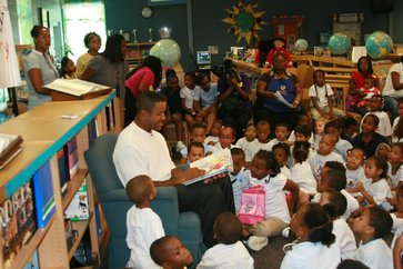 Brian Jordan reading to the youth.
